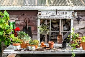 Garden Potting Bench Rustic Shed Reveal With Sawhorse Potting Bench And Old Rake Sign
