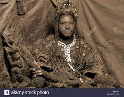 witch doctor and voodoo doll costume poached rhinoceros horn in the hands of a genuine african voodoo