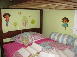 Decorating Bedroom With Green Walls Green Wall Theme With Dora Wall Paper Connected By Pink Bed Sheet