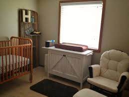 Metal Changing Table Comfy Buttoned Back Glider Next To White Sideboard Plus Changing