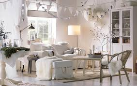 a white living room decorated with hanging ornaments and winter