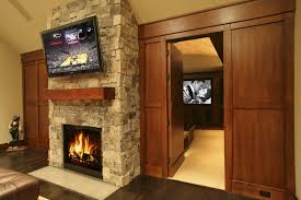 Modern Wall Units With Fireplace Stunning Hidden Theater Room Ideas Natural Exposed Stone Wall