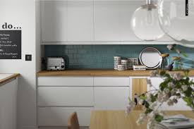contemporary handle less gloss white kitchen with oak accents