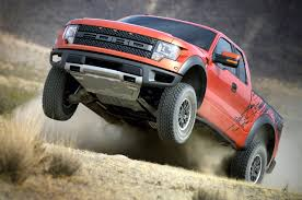 Ford Raptor Orange - internal triple bypass shocks debut on ford f 150 svt raptor utv