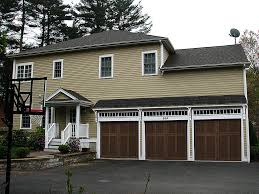 garage garage design outstanding private garage with brown outstanding private garage with brown wooden french door which has three capacity of three luxurious vehicle car and minibus