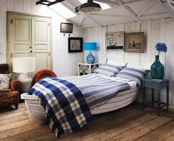 unique beach inspired bedroom design with custom wooden boat for