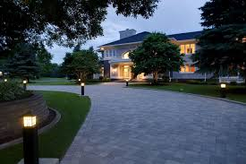 wide paver circular driveway with bright path lights to lead the