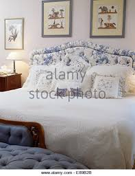 White Cushioned Headboard by Blue White Upholstered Headboard On Bed Stock Photos U0026 Blue White