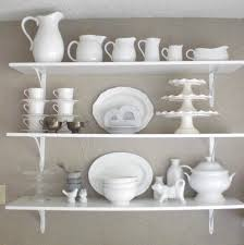 decorating ideas for kitchen shelves kitchen bright white kitchen wall shelf unit filled with some