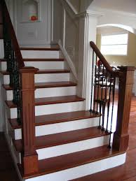 Wrought Iron And Wood Banisters For The Railing Heading Up To The Bedrooms Upstairs Either
