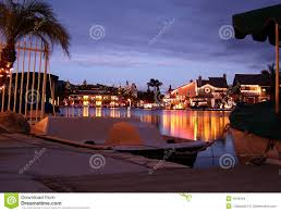 christmas lights on lake seen from boat dock stock images image