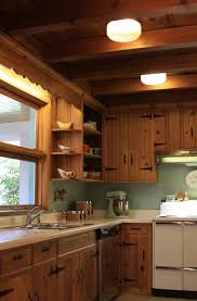 knotty pine kitchen cabinets a knotty pine kitchen respectfully retained and revived retro
