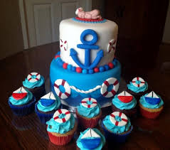 anchor theme baby shower two tier baby shower cake with anchor and with baby on top