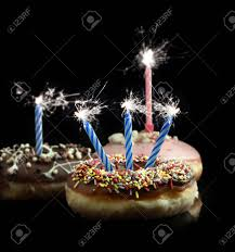 candle sparklers creative image of delicious donuts with blue and pink candle