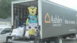 homestore ashley homestore jacksonville jaguars deliver new beds to 200