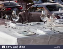 fine dining table setting in a restaurant with white tablecloth
