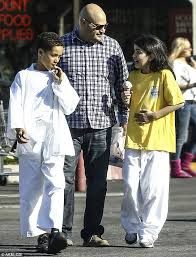 blanket jackson pulls a face while having ice cream after karate