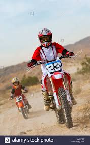 on road motocross bikes mother and son 5 6 on motocross bikes in desert stock photo