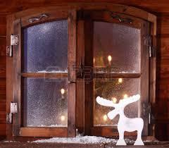 up snow on vintage wooden window pane captured