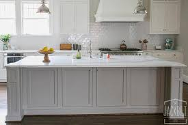 grey kitchen island grey center island with white marble counters transitional kitchen