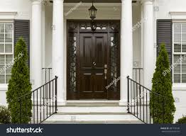 traditional style home entrance traditional style home black front stock photo 301773146