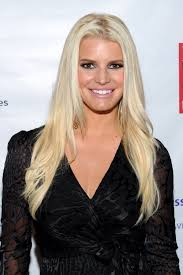 jessica simpson wants a breast reduction after dramatic weight