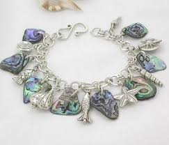 themed charm bracelet designer abalone shell and gemstone jewelry ll studio