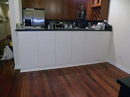 custom made bar cabinets custom painted cabinets under bar height counter by pryor craftsmen
