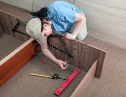 self assembling furniture at home woman housewife putting
