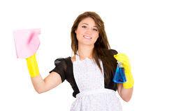 lesbienne femme de chambre femme de ménage heureuse dans les gants s usants d uniforme photo