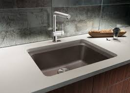 granite countertop kitchen sink art kohler black faucet costco