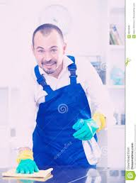 Cleaning Table Stock Images Royalty by Young Man In Apron Cleaning Table Stock Photo Image 86246582