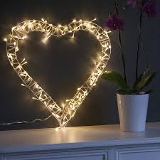 heart shaped christmas lights this beautiful heart wreath is decorated with soft white fairy