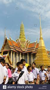 a group of thai children visit the temple of the emerald