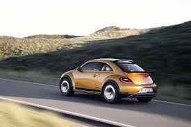 volkswagen beetle concept vw beetle dune concept takes to beach to show its production