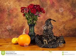 halloween flowers halloween still life with pumpkins witch hat and autumn flowers