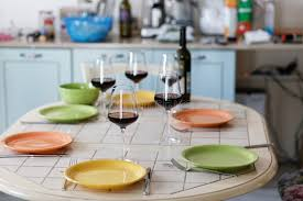 wine bottle plates wine glasses wine bottle and empty plates on the table stock
