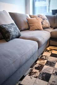 comfortable comfortable grey couch with pillows free stock photo