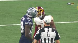 first thanksgiving nfl game dez bryant and josh norman come helmet to helmet during game nfl