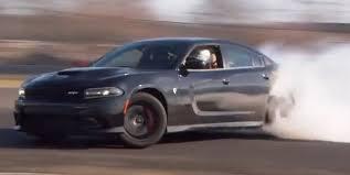 charger hellcat burnout watch the 2015 dodge charger srt hellcat drift video torque news