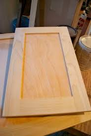 adding trim to existing plain kitchen cabinet doors this is my