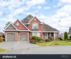 luxury brick house twocar garage beautiful stock photo 190178585
