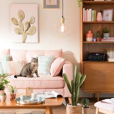boho gypsy home decor dreamy pink couch to complement pink and green home decor and