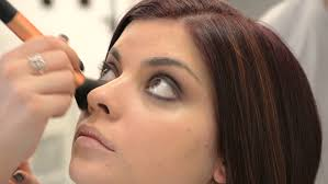 looking for makeup artist make up artist is using foundation in models make up stock footage