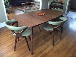 mix and match is the modern way to furnish a dining room