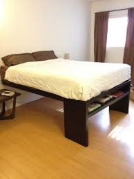 place your bed on a raised platform wood bed frame before
