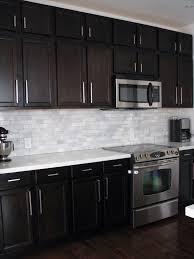 glass tile backsplash with dark cabinets gorgeous backsplash tile with dark cabinets decoration of landscape