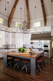 open kitchen with a vaulted ceiling and large central wooden open kitchen with a vaulted ceiling and large central wooden island in this home in big cedar lake wisconsin
