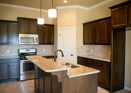 beacon homes kitchen warm stained cabinets tumbled travertine
