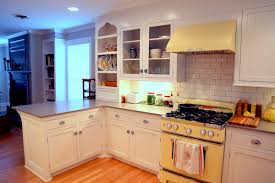 bright pastel blue refrigerator and electric range mosaic